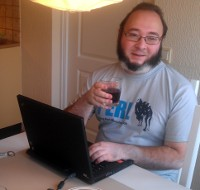 jnthn holding a glass of port