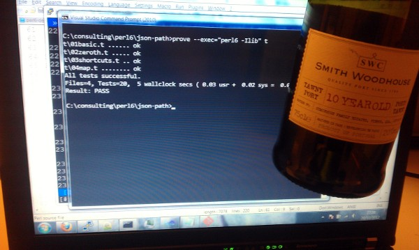 A picture of a screenshot and an empty bottle of port.